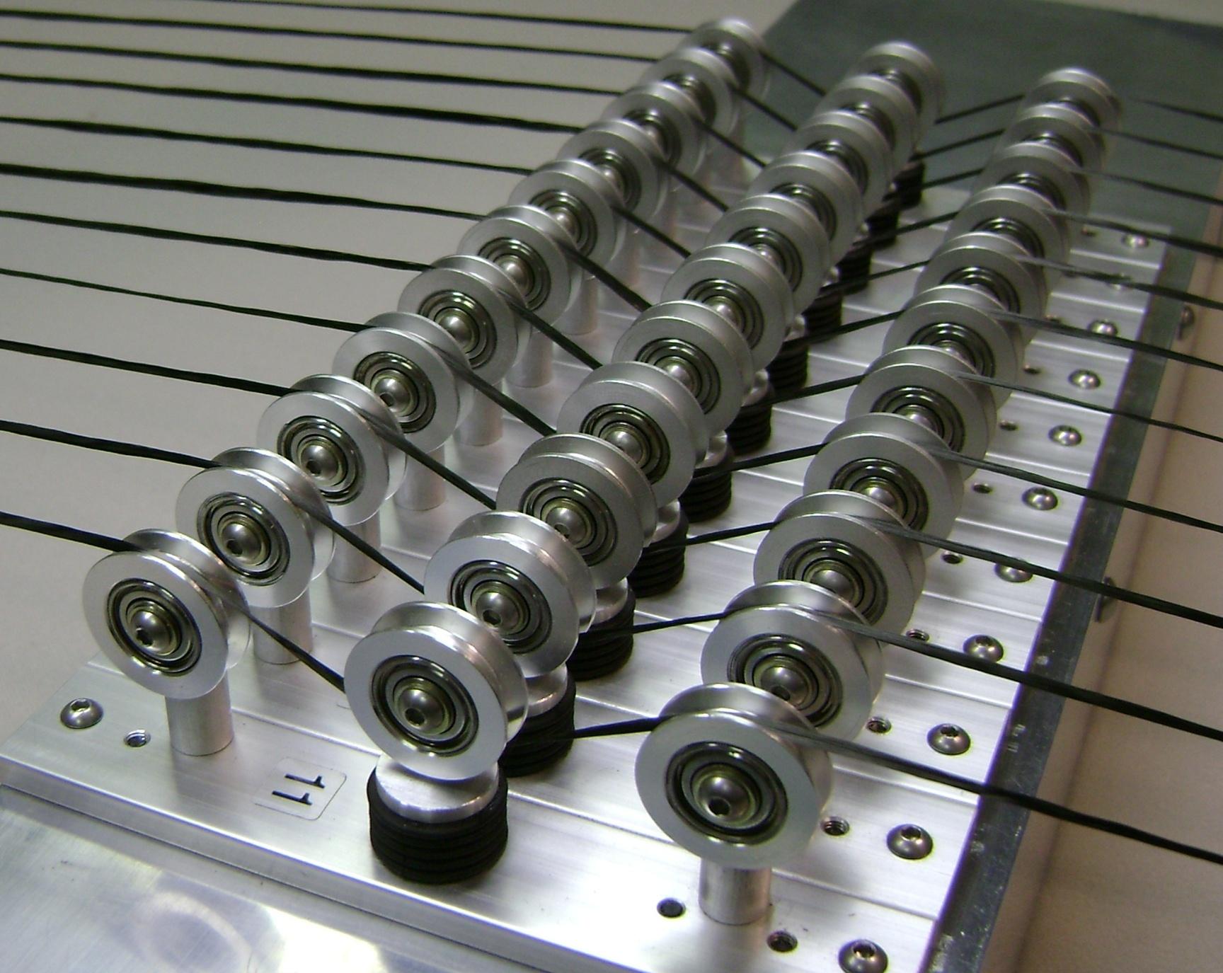 DTH carbon fiber tension sensor